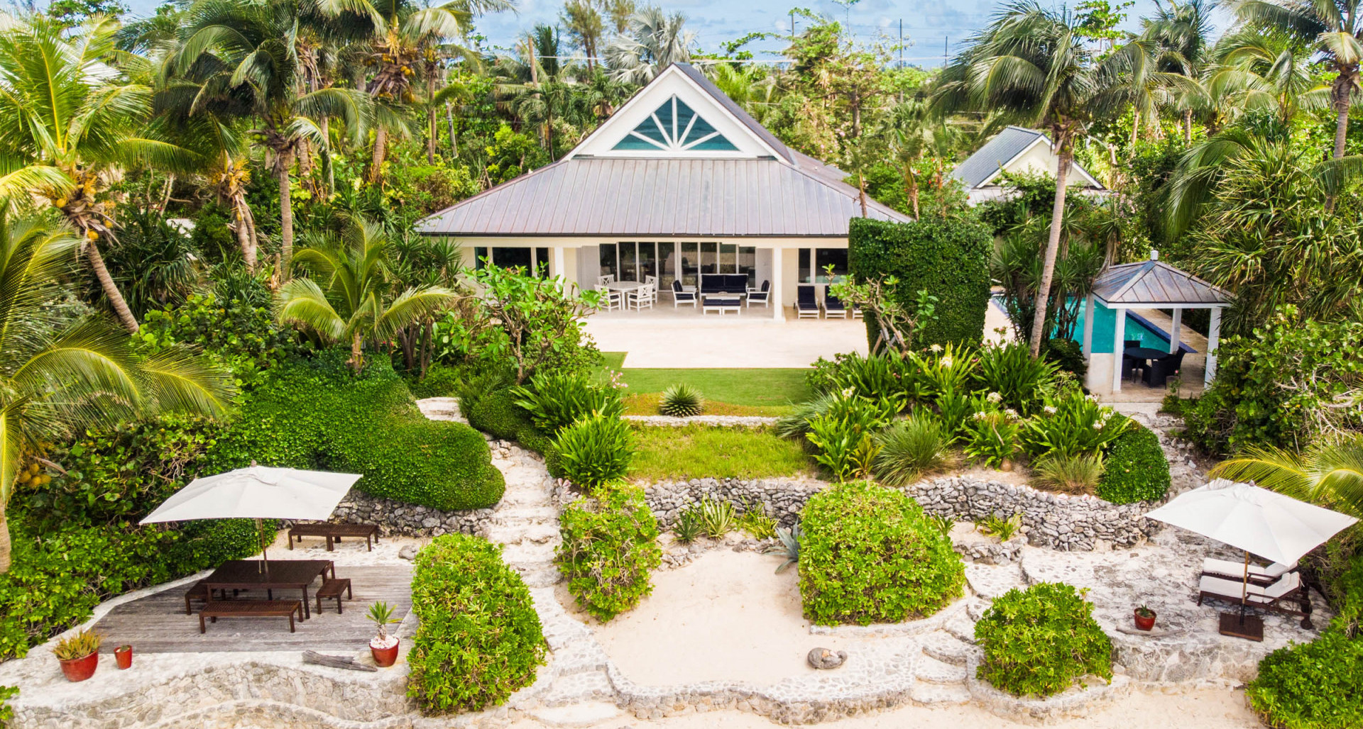 The Beach House plus one Acre Raw Land